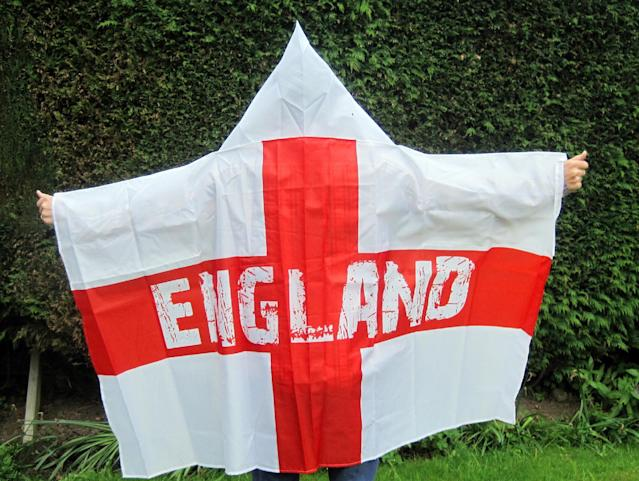 A man models a wearable England flag, made by Asda, in London, Friday, May 30, 2014. British supermarket chain Asda has been criticized for launching a wearable England flag ahead of the World Cup that some customers say resembles an outfit worn by U.S. far-right organization the Ku Klux Klan. Designers of the flag _ a St. George's Cross with the word 'England' on it _ included a white hood so fans could stay dry while wearing it. (AP Photo/PA, Carmel Wilkinson)
