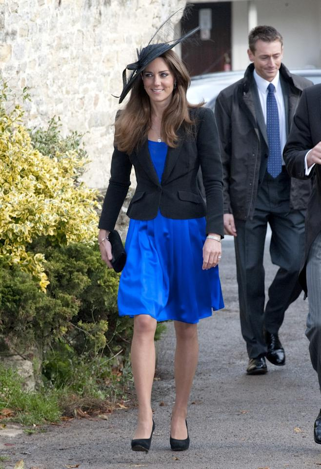 <p>Kate paired a neat black blazer with an electric blue Issa dress for a wedding in 2010. <em>(Photo: PA)</em> </p>