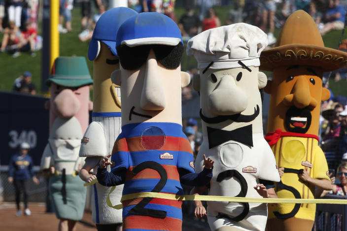 Polish Sausage (2) wins the sausage race between innings of a spring training baseball game between the Los Angeles Angels and the Milwaukee Brewers, Sunday, March 8, 2020, in Phoenix, Ariz. (AP Photo/Sue Ogrocki)