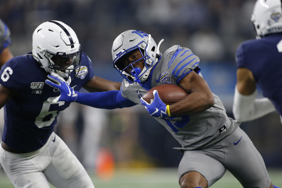 Dec 28, 2019; Arlington, Texas, USA;  Memphis Tigers running back Kenneth Gainwell (19) runs the ball against Penn State Nittany Lions linebacker Cam Brown (6) in the first quarter at AT&T Stadium. Mandatory Credit: Tim Heitman-USA TODAY Sports