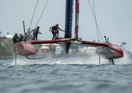 In this photo provided by SailGP, the Britain SailGP Team presented by INEOS, helmed by Sir Ben Ainslie, competes during the final on race Day 2 of the Bermuda SailGP event in Hamilton, Bermuda, Sunday, April 25, 2021. (Thomas Lovelockn/SailGP via AP)