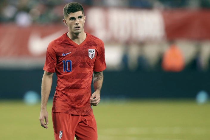 FILE - In this Sept. 6, 2019, file photo, United States midfielder Christian Pulisic pauses during an international friendly soccer match against Mexico in East Rutherford, N.J. Pulisic's availability for the United States' opening World Cup qualifier remains unclear following his positive COVID test. The top American player was on the 26-man roster announced Thursday for the first three qualifiers after missing Chelsea's match at Arsenal last weekend. The U.S. starts at El Salvador on Sept. 2. (AP Photo/Steve Luciano, File)