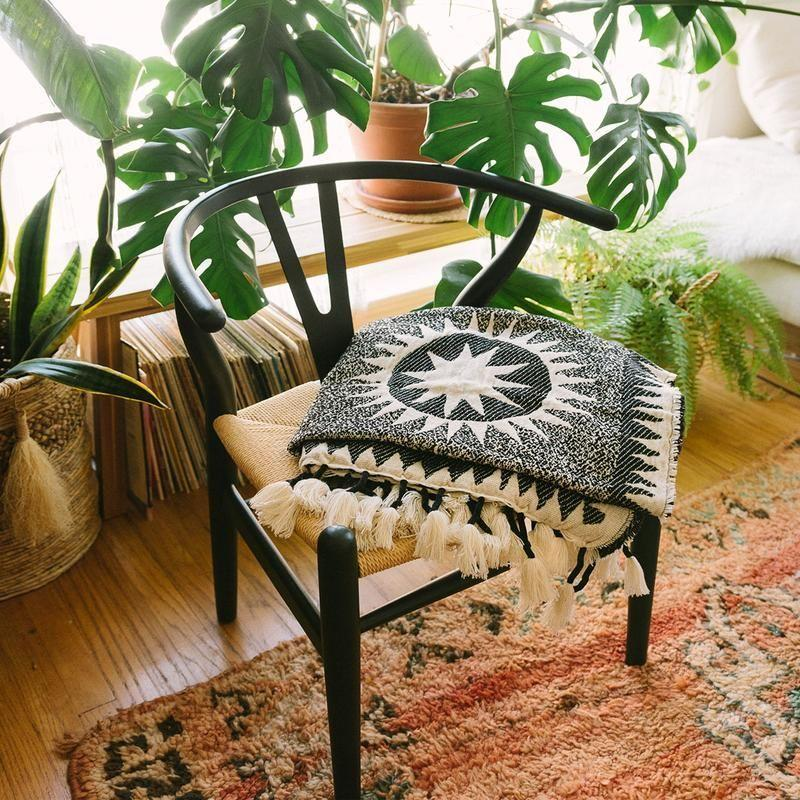 """<p><strong>Jungalow</strong></p><p>jungalow.com</p><p><strong>$99.00</strong></p><p><a href=""""https://www.jungalow.com/collections/throw-blankets/products/soleil-throw-by-justina-blakeney"""" rel=""""nofollow noopener"""" target=""""_blank"""" data-ylk=""""slk:Shop Now"""" class=""""link rapid-noclick-resp"""">Shop Now</a></p><p>For those who love looking up, here's a cozy throw featuring beautiful sun medallions all over it.</p>"""