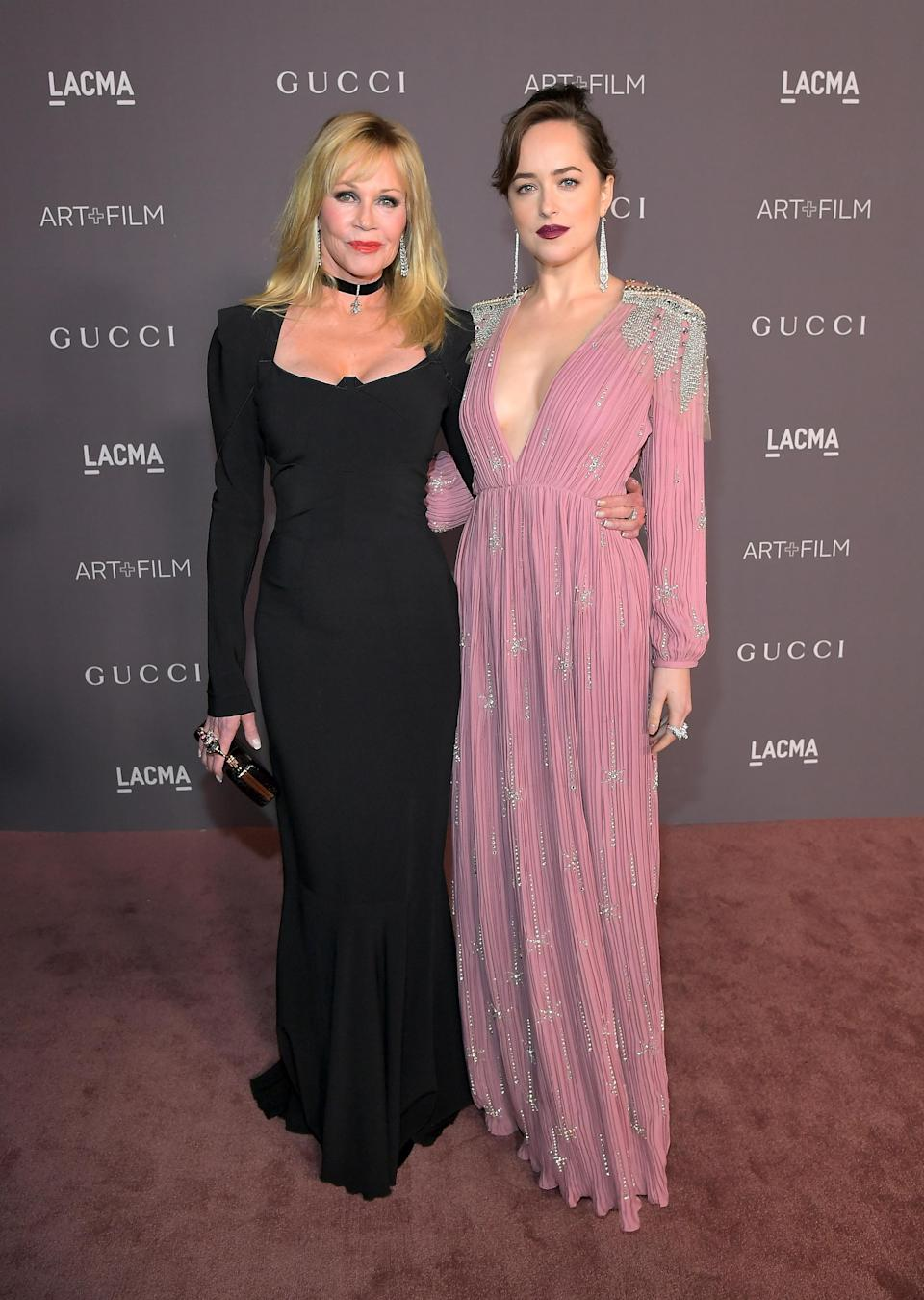 <p>'Working Girl' star Melania Griffith might be a blonde and her '50 Shades' daughter a brunette, but the similarities are there. The mother/daughter duo have made a number of red carpet appearances together, at awards ceremonies, film premieres and charity events. <em>[Photo: Getty]</em> </p>