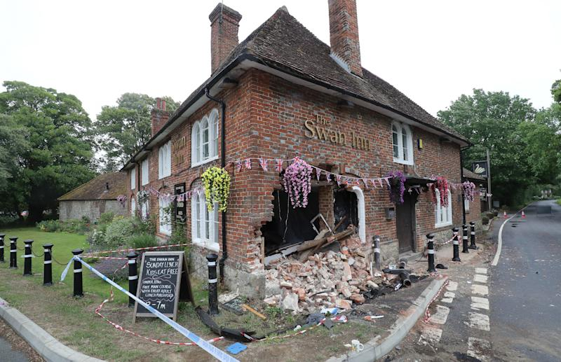 A view of scene outside The Swan Inn in Ashford, Kent, after a car crashed into the pub during the early hours of this morning wrecking their plans for reopening as coronavirus lockdown restrictions are eased across England.