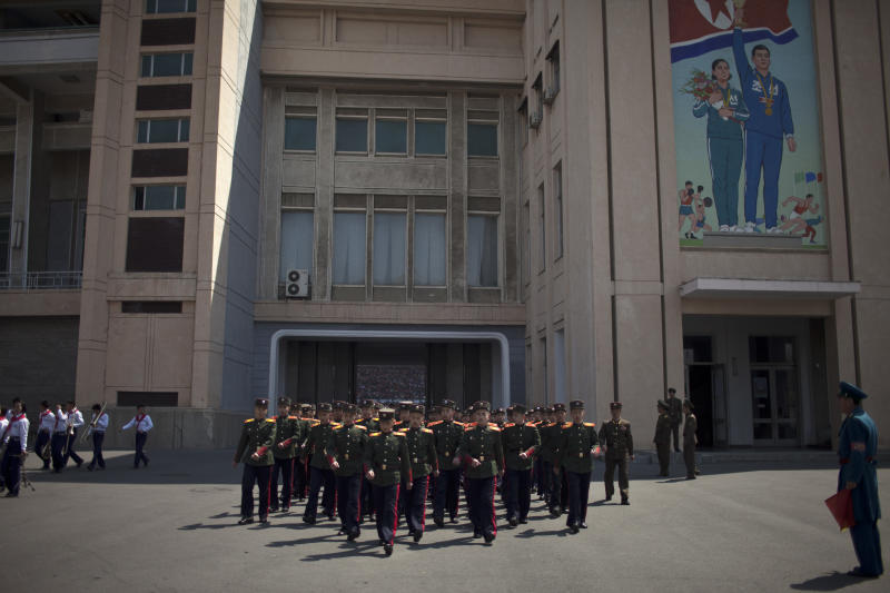 Military cadets march out of a stadium after a ceremony to induct children into the Korean Children's Union, the first political organization for North Koreans, held at a stadiu in Pyongyang, North Korea, Friday, April 12, 2013. (AP Photo/Alexander F. Yuan)