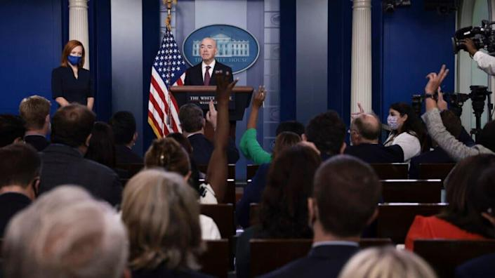 Reporters raise their hands with questions during a press briefing with U.S. Homeland Security Secretary Alejandro Mayorkas at the White House on September 24, 2021 in Washington, DC. (Photo by Anna Moneymaker/Getty Images)