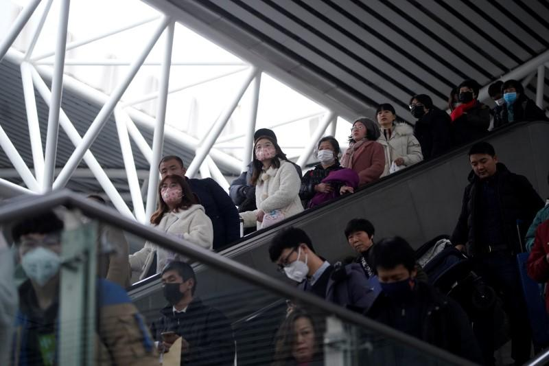 Passengers wearing masks are seen at Shanghai railway station in Shanghai