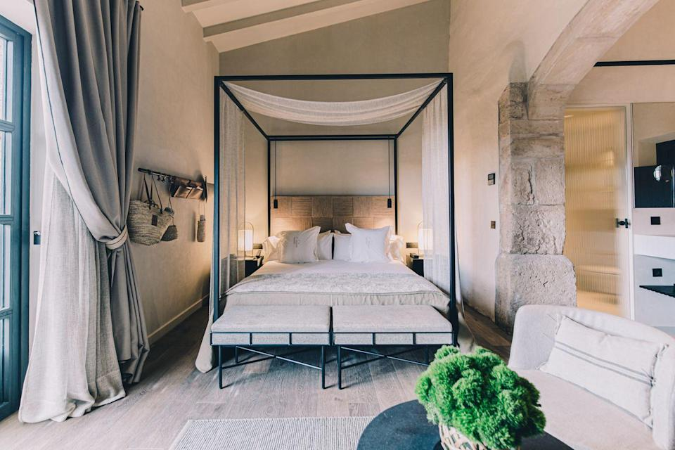 "<p>Just southeast of Mallora lies the charming town of Santanyí where a 17th century estate surrounded by verdant gardens that has been immaculately restored into <a href=""https://hotelcanferrereta.com/en"" rel=""nofollow noopener"" target=""_blank"" data-ylk=""slk:Can Ferrereta"" class=""link rapid-noclick-resp"">Can Ferrereta</a>. This storybook destination houses 32 rooms and suites, a Mediterranean restaurant that features seasonal dishes with local ingredients, a beautiful spa, bath house, pool and bar, and magical views at every turn. It's designed to feel like a bed and breakfast with all the amenities expected of a larger luxury property.</p><p><em>Can Ferrereta is expected to open in March 2021 with rates starting at $380 per night.</em></p>"