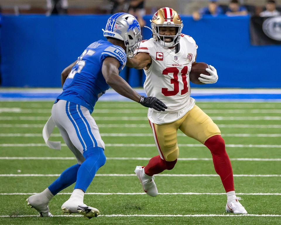 Raheem Mostert runs with the ball in Week 1 against hte Lions.
