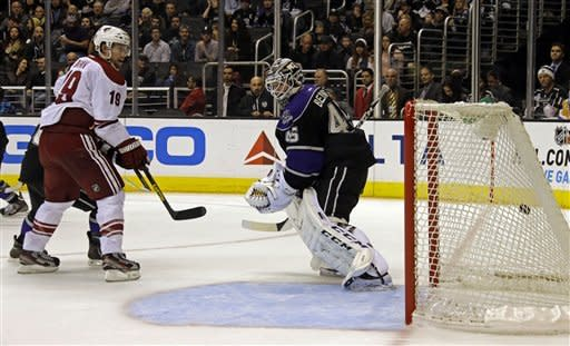 Phoenix Coyotes right winger Shane Doan (19) ends a long Coyotes scoring drought as he makes the first of his two goals against Los Angeles Kings goalie Jonathan Bernier (45) in the third period of an NHL hockey game in Los Angeles Tuesday, March 19, 2013. But the Kings won, 3-2. (AP Photo/Reed Saxon)
