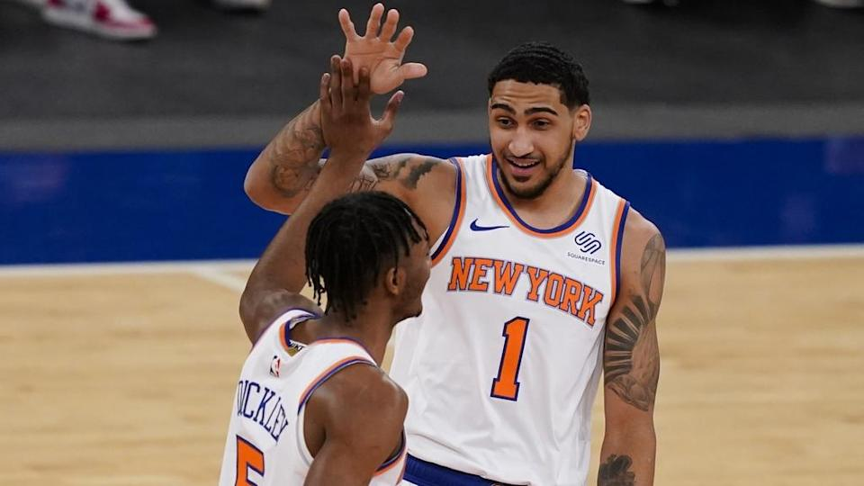 Feb 25, 2021; New York, New York, USA; New York Knicks guard Immanuel Quickley (5) celebrates with forward Obi Toppin (1) after scoring against the Sacramento Kings in the first half at Madison Square Garden.