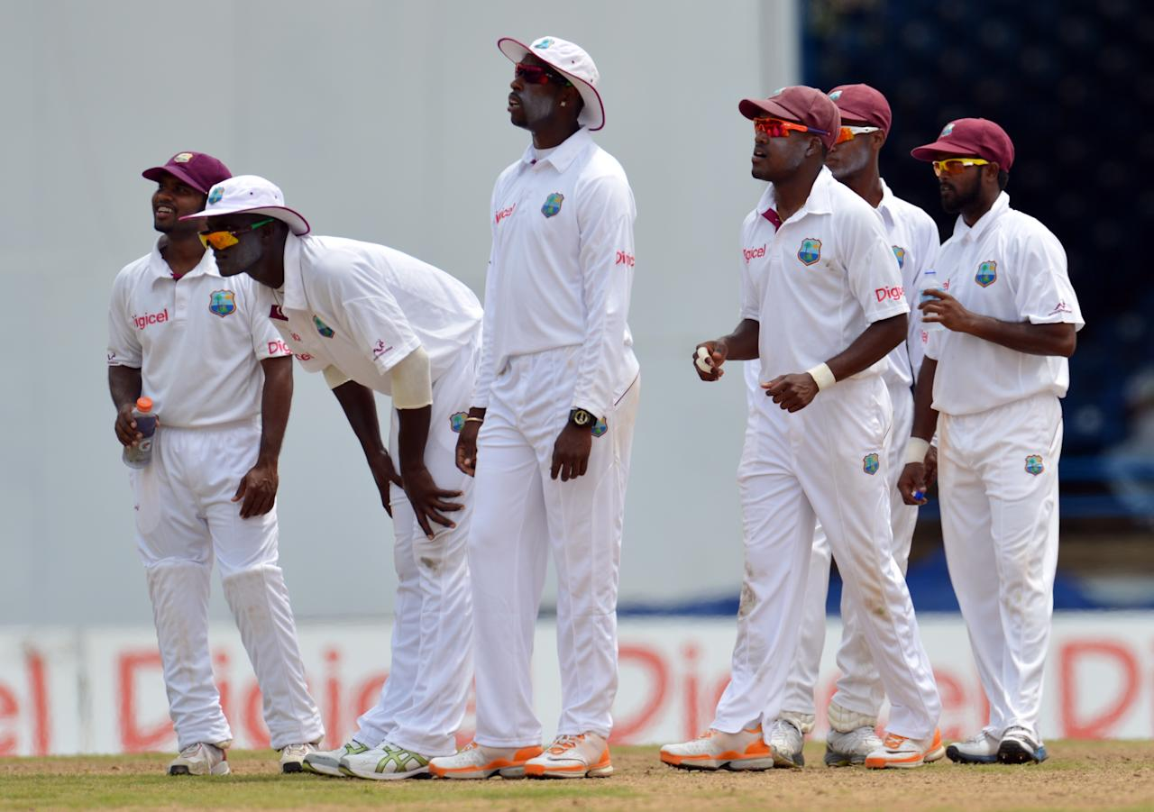 West Indies team waits for lbw review against Australian batsman Ed Cowan during the fourth day of the second-of-three Test matches between Australia and West Indies April 18, 2012 at Queen's Park Oval in Port of Spain, Trinidad. West Indies won appeal on review.