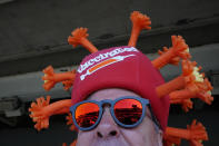 Mark Ferguson wears a coronavirus-themed hat before the 147th running of the Kentucky Derby at Churchill Downs, Saturday, May 1, 2021, in Louisville, Ky. (AP Photo/Brynn Anderson)