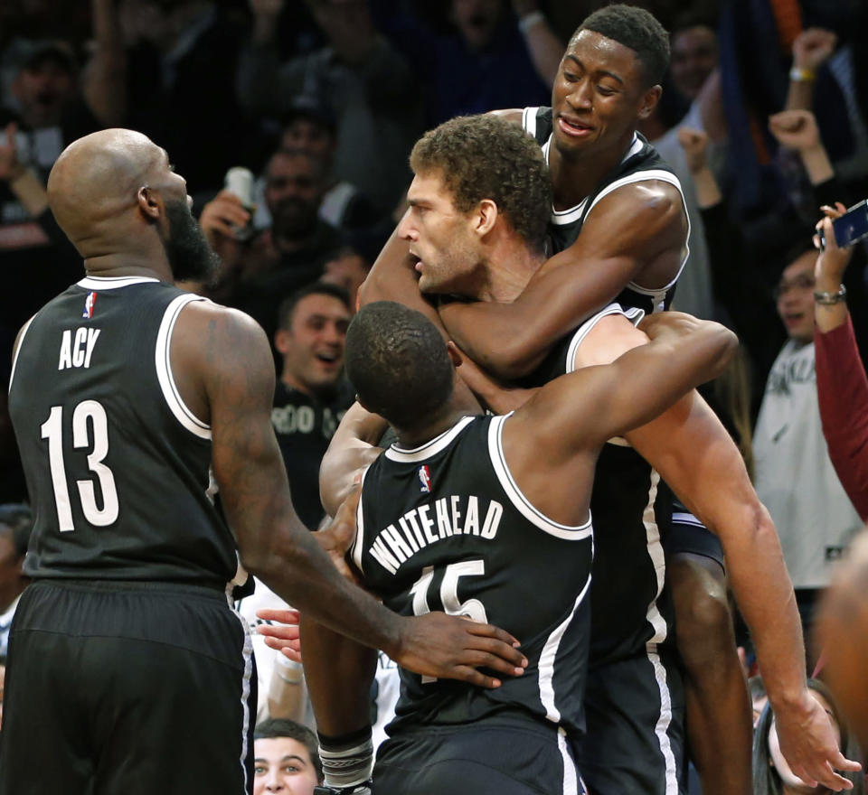 The Brooklyn Nets don't win often, so they celebrate hard when they do. (AP)