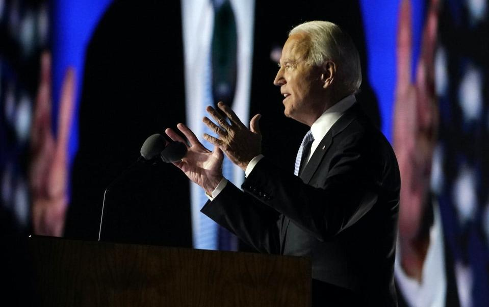 "<span class=""caption"">President-elect Joe Biden speaks to supporters on Nov. 7 in Wilmington, Del.</span> <span class=""attribution""><a class=""link rapid-noclick-resp"" href=""https://newsroom.ap.org/detail/Election2020Biden/ff1eb344b5274dafbda614d08d10b83f/photo?Query=biden%20AND%20del&mediaType=photo&sortBy=arrivaldatetime:desc&dateRange=Anytime&totalCount=3496&currentItemNo=15"" rel=""nofollow noopener"" target=""_blank"" data-ylk=""slk:AP Photo/Carolyn Kaster"">AP Photo/Carolyn Kaster</a></span>"