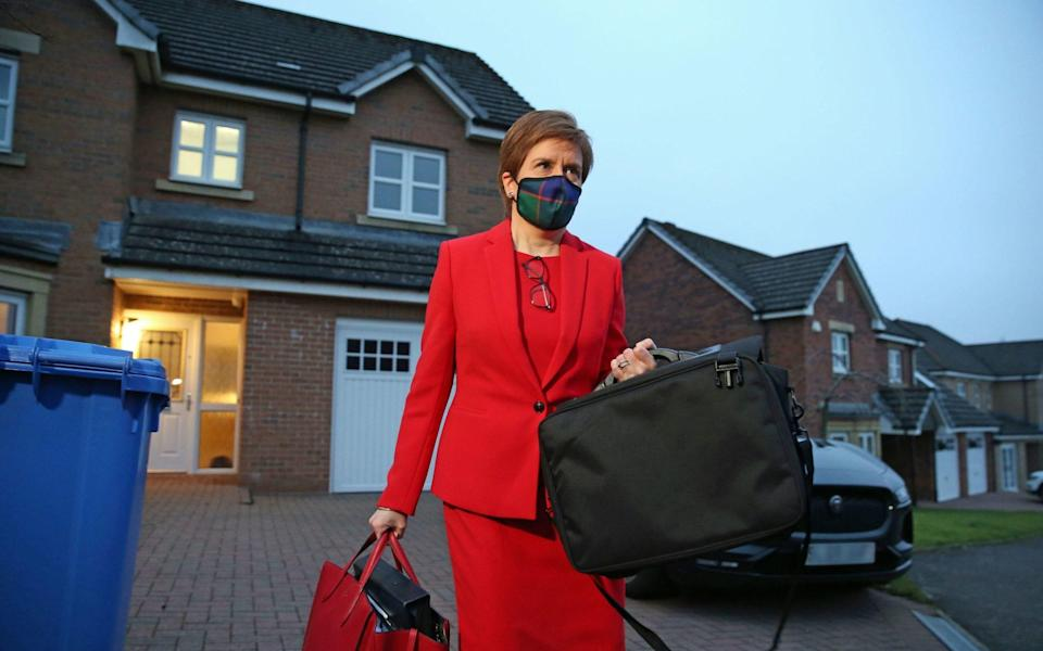 Nicola Sturgeon, leaves her home in Glasgow to head to Holyrood in Edinburgh to give evidence to the Scottish Parliament's inquiry into her government's unlawful investigation of the former First Minister Alex Salmond - PA