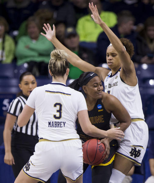 Bethune-Cookman's Chasimmie Brown, center, gets pressure from Notre Dame's Marina Mabrey (3) and Brianna Turner during a first-round game in the NCAA womens college basketball tournament in South Bend, Ind., Saturday, March 23, 2019. (AP Photo/Robert Franklin)