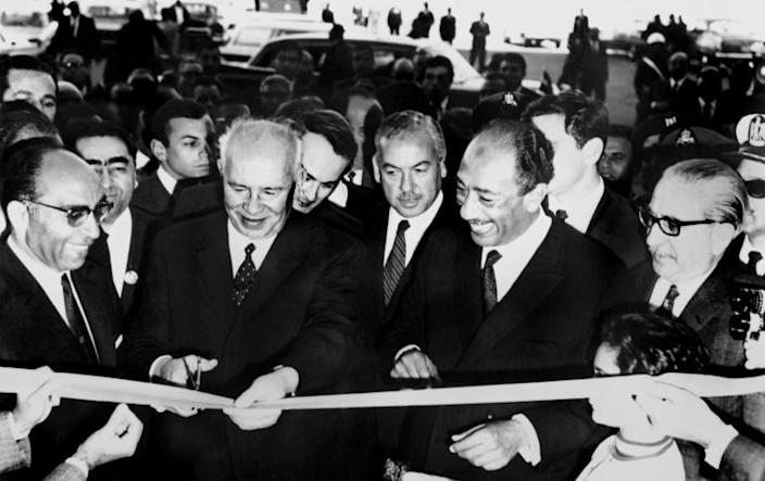 High water mark: Head of the USSR's Supreme Soviet Nikolai Podgorny cuts the ribbon alongside Egyptian President Anwar al-Sadat (2nd R) at the inauguration of the Aswan High Dam, on January 15, 1971