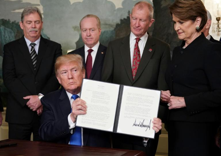 "In what he called ""the first of many"" trade actions, President Donald Trump signed an order imposing tariffs on as much as $60 billion in Chinese products"