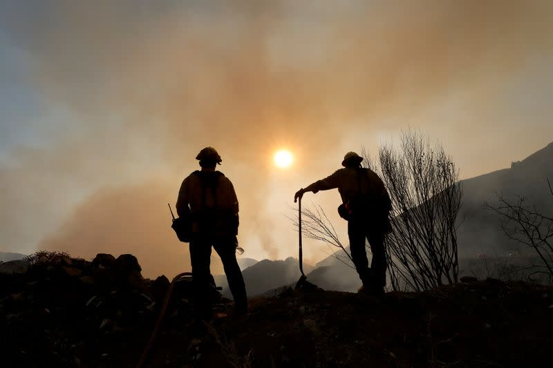 Crews make headway against massive California wildfire