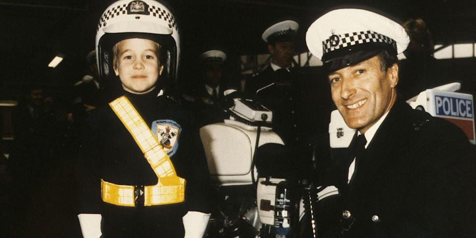 <p>Prince Harry dressing in a police uniform during a visit to the police force in Windsor.</p>