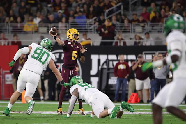 "Arizona State quarterback <a class=""link rapid-noclick-resp"" href=""/ncaaf/players/299079/"" data-ylk=""slk:Jayden Daniels"">Jayden Daniels</a> threw for 408 yards and three touchdowns in a win over Oregon. (Photo by Christian Petersen/Getty Images)"