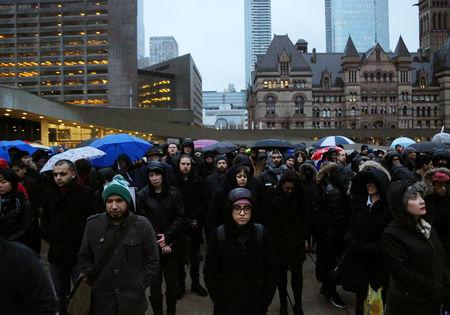 People attend a vigil for victims of the mosque shootings in New Zealand, outside city hall in Toronto, Ontario, Canada March 15, 2019.  REUTERS/Chris Helgren