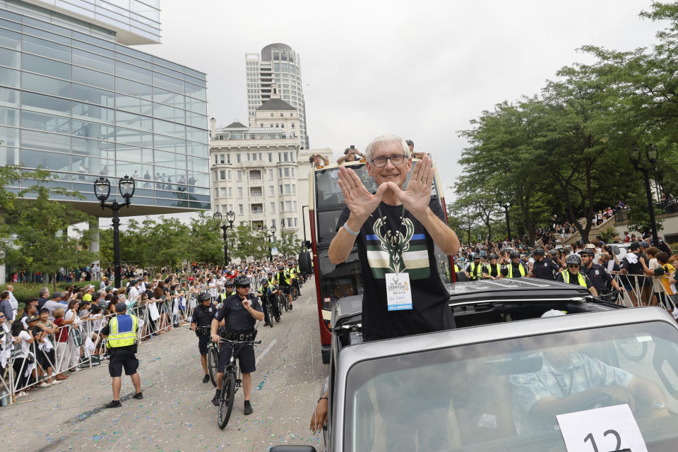 Wisconsin Governor Tony Evers takes part in parade for the NBA Champion Milwaukee Bucks basketball team Thursday, July 22, 2021, in Milwaukee. (AP Photo/Jeffrey Phelps)
