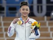 Gold medallist Sunisa Lee of the Unites States displays her medal for the artistic gymnastics women's all-around at the 2020 Summer Olympics, Thursday, July 29, 2021, in Tokyo. (AP Photo/Gregory Bull)