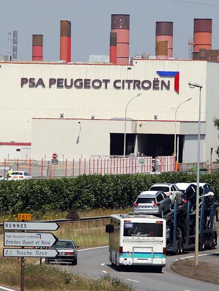 FILE - This July 26, 2012 file photo shows the PSA Peugeot Citroen factory of Rennes, western France. France is offering a euro7 billion ($9.1 billion) lifeline to PSA Peugeot Citroen, the carmaker confirmed Wednesday, Oct.24, 2012 alongside another drop in sales. In return, the Socialist government is expected to demand a reduction in layoffs, hoping to blunt rising unemployment in a sector critical to the French economy. (AP Photo/David Vincent, File)
