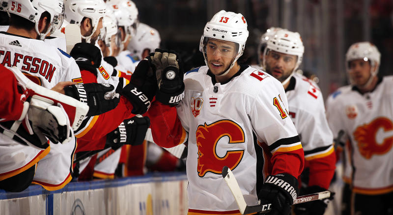 Johnny Gaudreau of the Calgary Flames celebrates with his teammates after scoring the opening goal against the Florida Panthers on Sunday. (Photo by Eliot J. Schechter/NHLI via Getty Images)