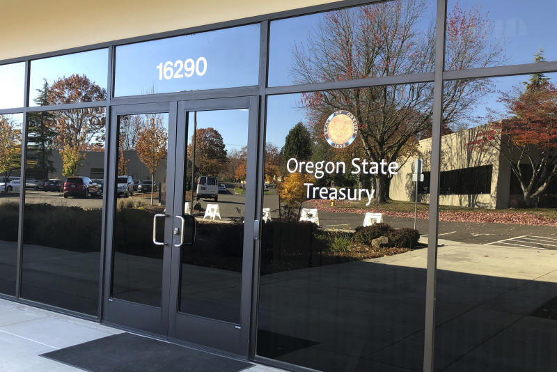 This Oct. 30, 2019, photo shows the Oregon State Treasury office in Tigard, Ore. In the nondescript building in an office park, decisions are made about investments of billions of dollars. Rukaiyah Adams, chairwoman of the Oregon Investment Council, says the Oregon State Treasury should do more to take into account issues such as climate change and human rights when making investment decisions. (AP Photo/Andrew Selsky)