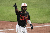 Baltimore Orioles' Cedric Mullins gestures after hitting a solo home run off Toronto Blue Jays starting pitcher Anthony Kay during the seventh inning of a baseball game, Saturday, June 19, 2021, in Baltimore. (AP Photo/Julio Cortez)