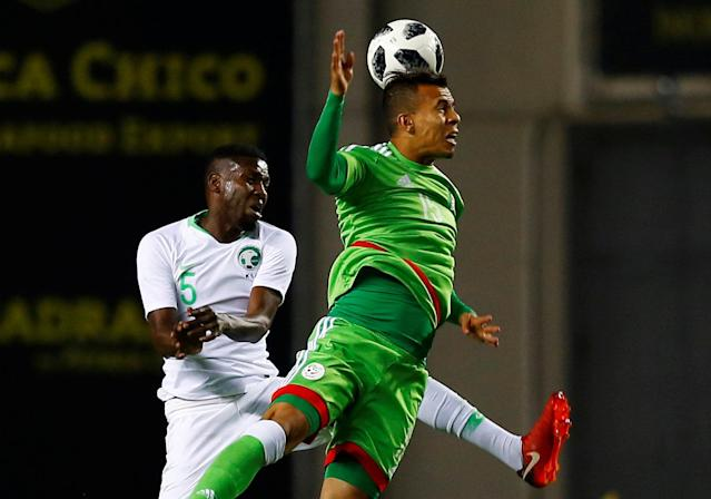 Soccer Football - International Friendly - Saudi Arabia v Algeria - Estadio Ramon de Carranza, Cadiz, Spain - May 9, 2018 Saudi Arabia's Omar Hawsawi in action with Algeria's Habib Bouguelmouna REUTERS/Marcelo Del Pozo