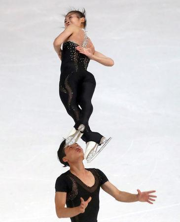 FILE PHOTO: Figure Skating - Olympic Qualifying ISU Challenger Series - Pairs Free Skating - Oberstdorf, Germany - September 29, 2017 - Ryom Tae-Ok and Kim Ju-Sik of North Korea compete. REUTERS/Michael Dalder/File Photo