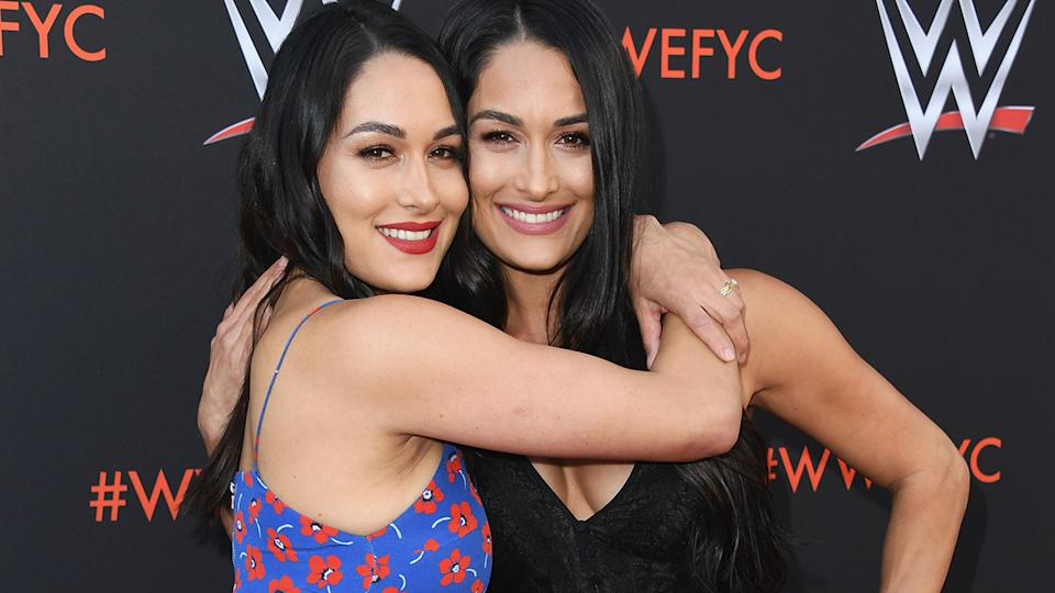 Brie and Nikki Bella, pictured here at a WWE event in 2018.