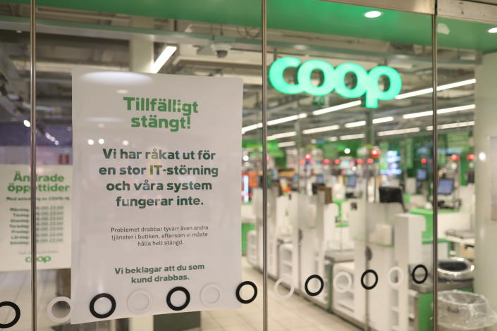 """FILE - In this July 3, 2021 file photo, a sign reads: """" Temporarily Closed. We have an IT-disturbance and our systems are not functioning"""", posted in the window of a closed Coop supermarket store in Stockholm, Sweden. Cybersecurity teams worked feverishly Sunday July 4, 2021, to stem the impact of the single biggest global ransomware attack on record, with some details emerging about how the Russia-linked gang responsible breached the company whose software was the conduit. The Swedish grocery chain Coop said most of its 800 stores would be closed for a second day Sunday because their cash register software supplier was crippled. (Ali Lorestani/TT via AP, File)"""