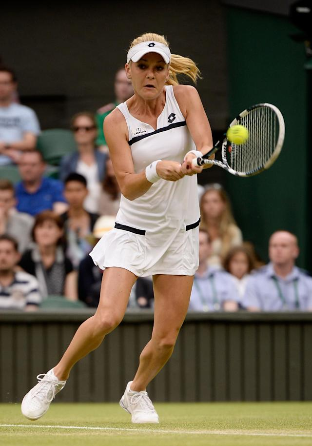 LONDON, ENGLAND - JUNE 27: Agnieszka Radwanska of Poland plays a backhand during the Ladies' Singles second round match against Mathilde Johansson of France on day four of the Wimbledon Lawn Tennis Championships at the All England Lawn Tennis and Croquet Club on June 27, 2013 in London, England. (Photo by Dennis Grombkowski/Getty Images)