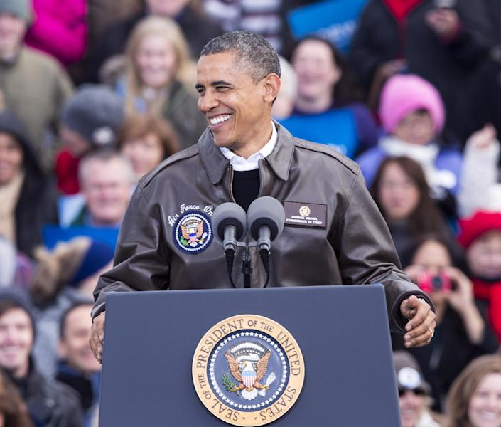 President Barack Obama smiles as supporters cheer at Austin Straubel International Airport in Green Bay, Wis.,Thursday, Nov. 1, 2012, during a quick campaign stop before heading to Las Vegas. (AP Photo/Tom Lynn)