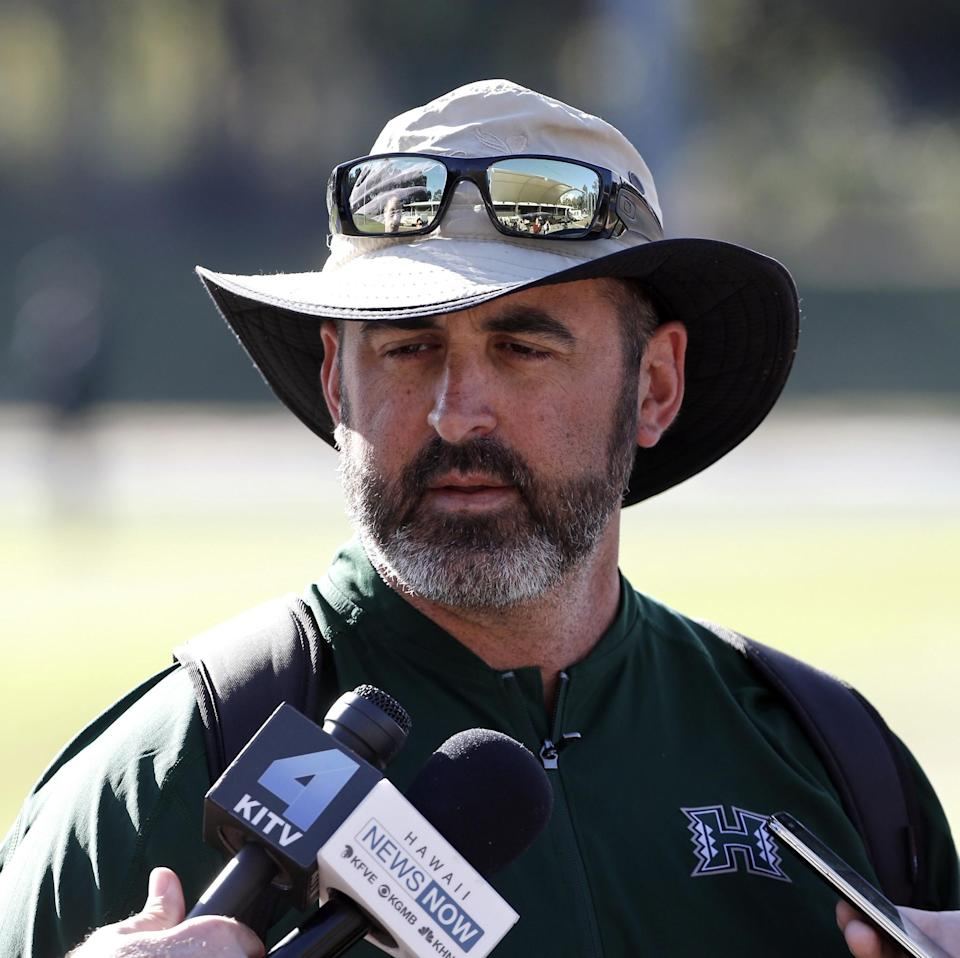 Hawaii Rainbow Warriors' coach Nick Rolovich speaks to media during a training run at a field in Sydney, Australia, Friday, Aug. 26, 2016. (AP Photo/Rob Griffith)
