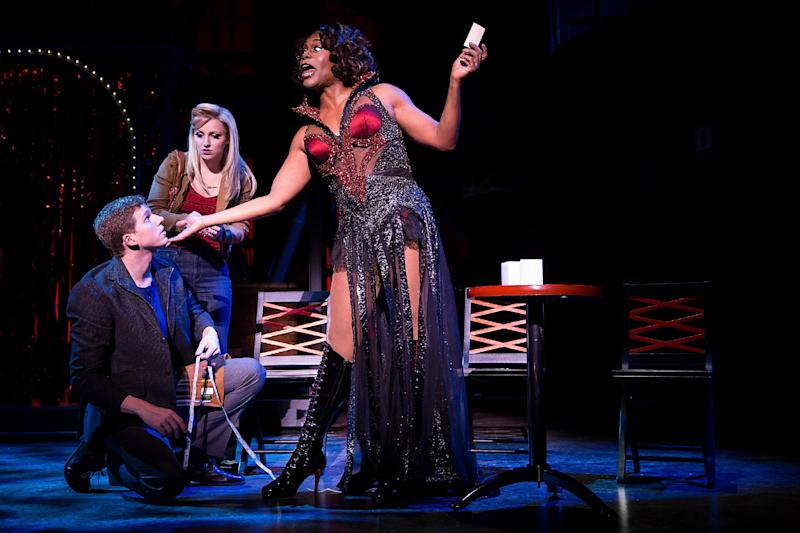 "This theater image released by The O+M Company shows, from left, Stark Sands, Annaleigh Ashford,and Billy Porter during a performance of ""Kinky Boots."" (AP Photo/The O+M Company, Matthew Murphy)"
