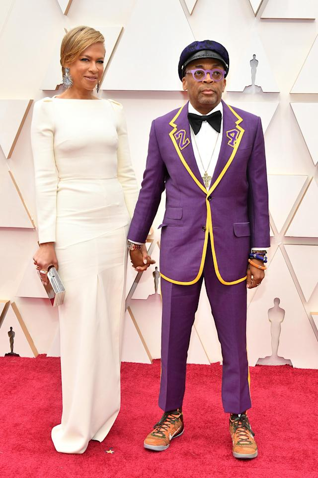 Spike Lee honors Kobe Bryant by wearing a custom purple and gold suit decorated with the number 24. (Photo: Getty Images)