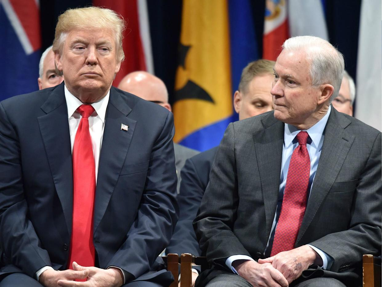 US President Donald Trump sits with Attorney General Jeff Sessions on 15 December 2017 in Quantico, Virginia: NICHOLAS KAMM/AFP/Getty Images