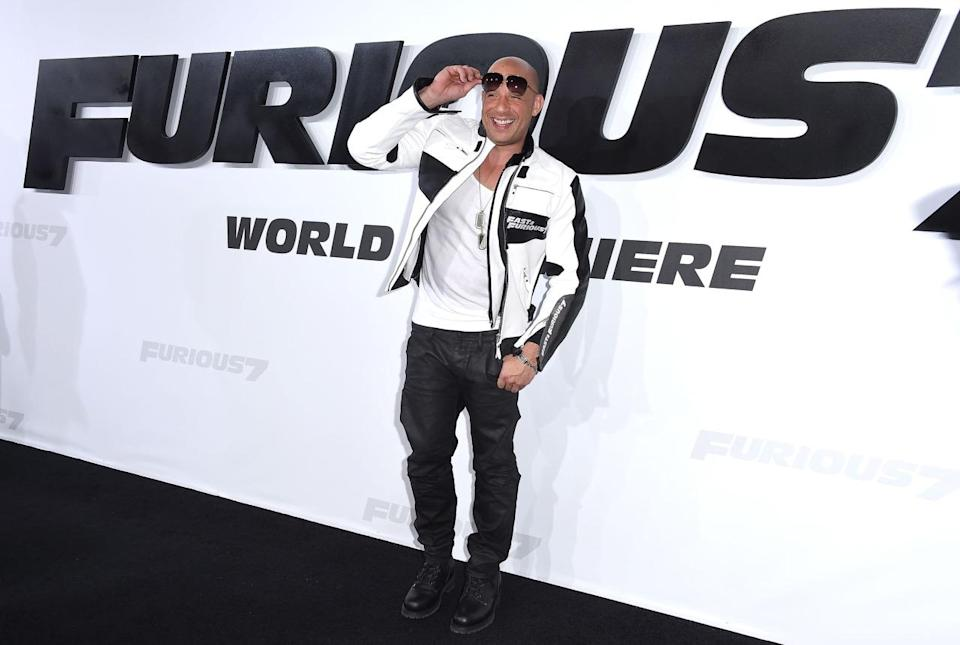 """Vin Diesel basically stayed in character on the black carpet, wearing a custom black and white motorcycle jacket with """"Fast & Furious"""" insignia. He paired it with leather pants, black boots, a white bro tank, dog tag necklaces, aviator sunglasses, and a sunkissed tan."""