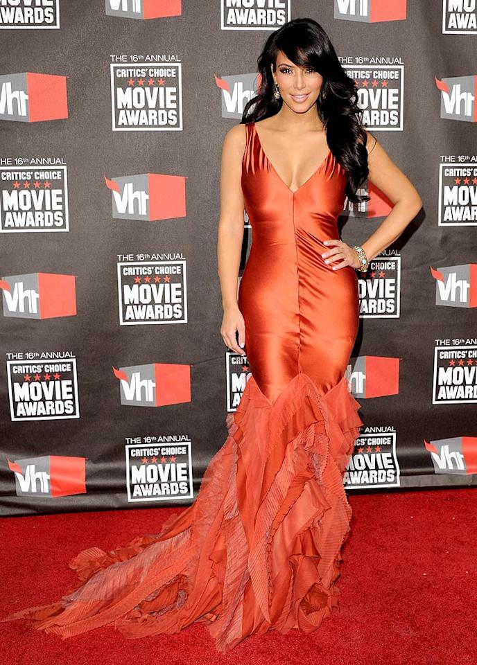 "Kim Kardashian set the red carpet on fire at the Critics' Choice Awards thanks to her form-fitting Vera Wang gown. Arunashi earrings and a Bavna bracelet completed her sexy ensemble. Jon Kopaloff/<a href=""http://filmmagic.com/"" target=""new"">FilmMagic.com</a> - January 15, 2011"