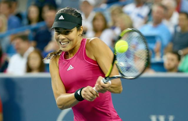 CINCINNATI, OH - AUGUST 16: Ana Ivanovic of Serbia hits a return during her match against Maria Sharapova of Russia on day 8 of the Western & Southern Open on August 16, 2014 at the Linder Family Tennis Center in Cincinnati, Ohio. Andy Lyons/Getty Images/AFP (AFP Photo/ANDY LYONS)