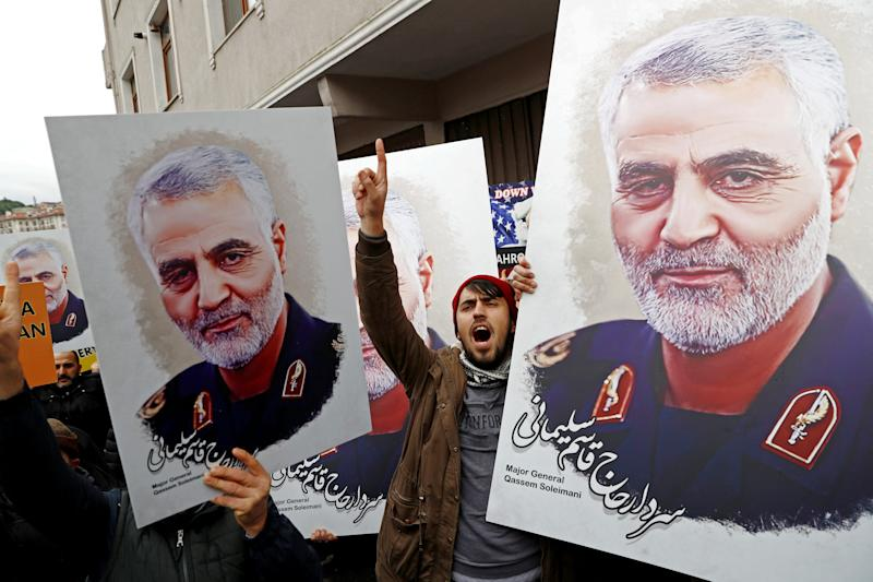 FILE PHOTO: Demonstrators hold placards depicting Iranian Major-General Qassem Soleimani, during a protest against killing of Soleimani, head of the elite Quds Force, who died in an air strike at Baghdad airport, outside U.S. Consulate in Istanbul, Turkey, January 5, 2020. REUTERS/Murad Sezer