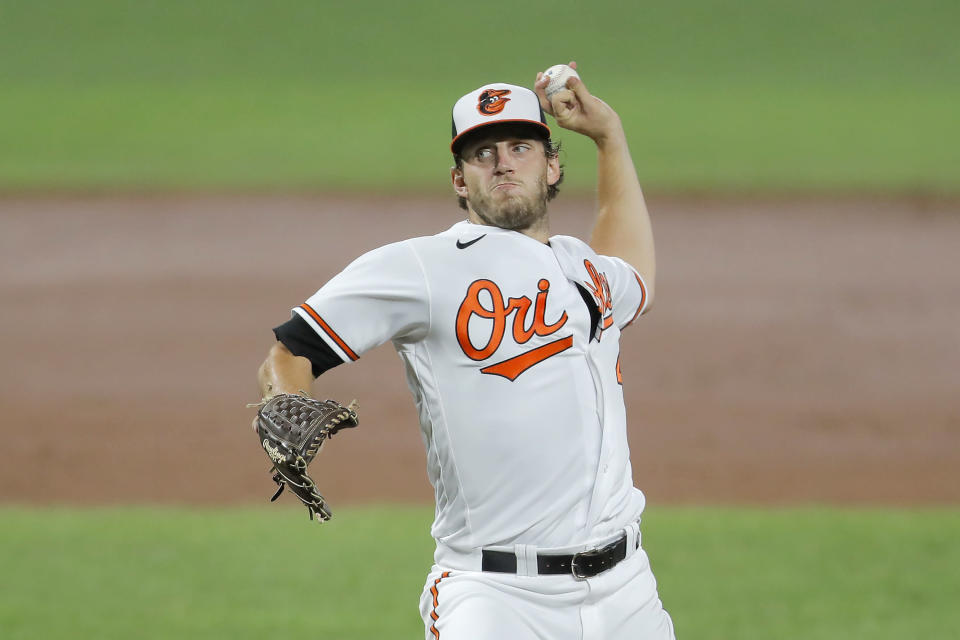 Baltimore Orioles starting pitcher John Means throws a pitch to the Miami Marlins during the third inning of a baseball game, Tuesday, Aug. 4, 2020, in Baltimore. (AP Photo/Julio Cortez)