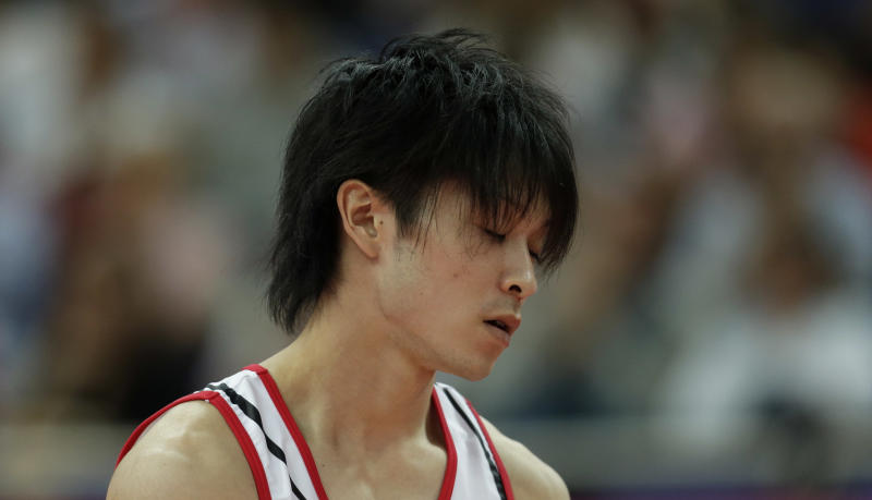 Japanese gymnast Kohei Uchimura reacts after a performance during the Artistic Gymnastics men's qualification at the 2012 Summer Olympics, Saturday, July 28, 2012, in London. (AP Photo/Gregory Bull)